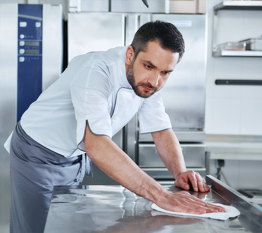 chef cleaning the kitchen